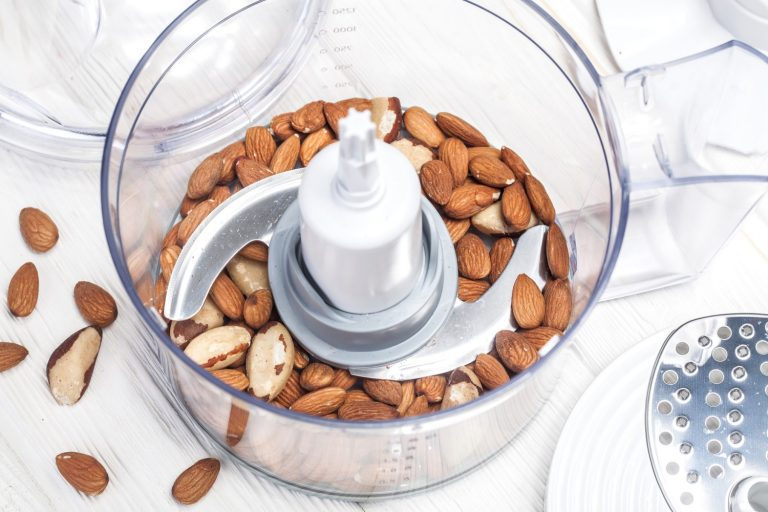 Almonds getting chopped in a food processor