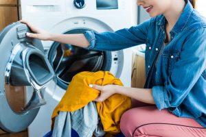 Woman emptying the washing machine