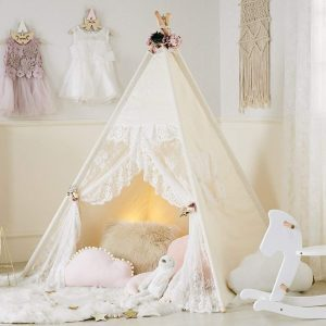 Ethereal lace teepee tent in a kids' room with white walls