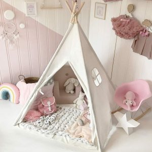 Cute Tiny Land teepee tent in a pink-white kids' room