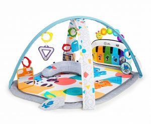 Music and language discovery play mat with a piano