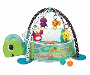 Baby play mat shaped like a turtle with a ball pit and toys