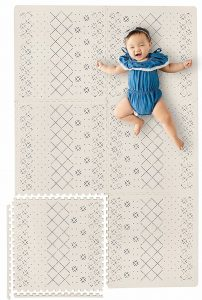Baby playing on a Yay Mats baby play mat