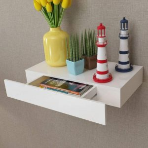 Wooden floating shelf with a hidden drawer
