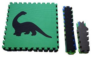 Green baby play mat with a dinosaur motif