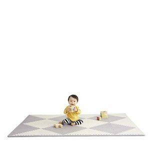 Baby on a white-gray checkered SkipHop play mat