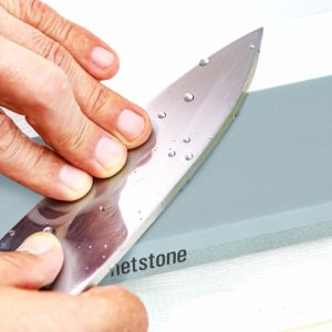 Knife getting sharpened on a Whetstone Cutlery knife sharpening block
