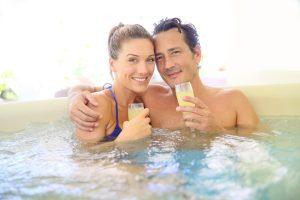 Couple enjoying their hot tub outside