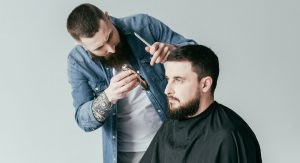 Man at a barber shop getting his hair trimmed
