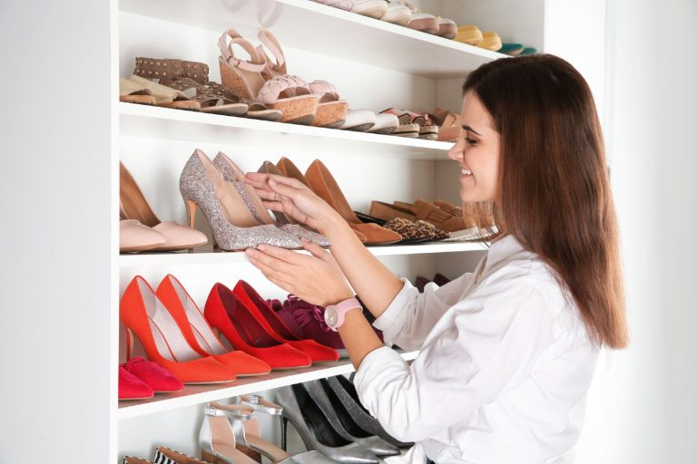 Woman showing off her shoe storage