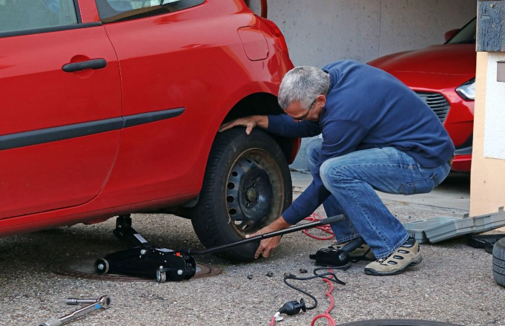 Man changing tires at home