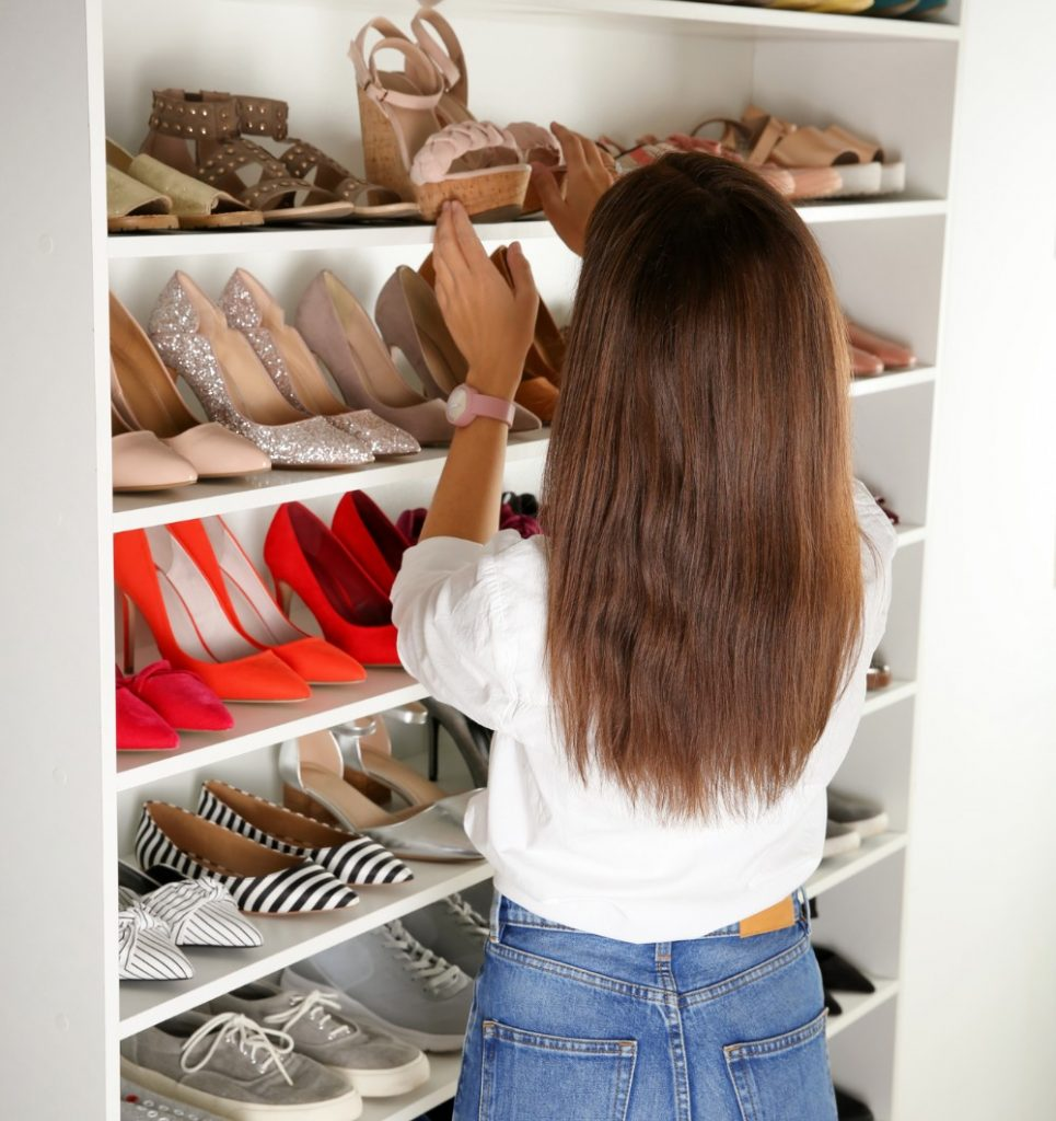 Woman organizing her shoe storage
