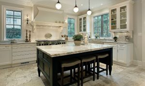 Kitchen island with a granite countertop and dark wooden finish with seating