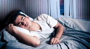 Man sleeping peacefully in a bedroom