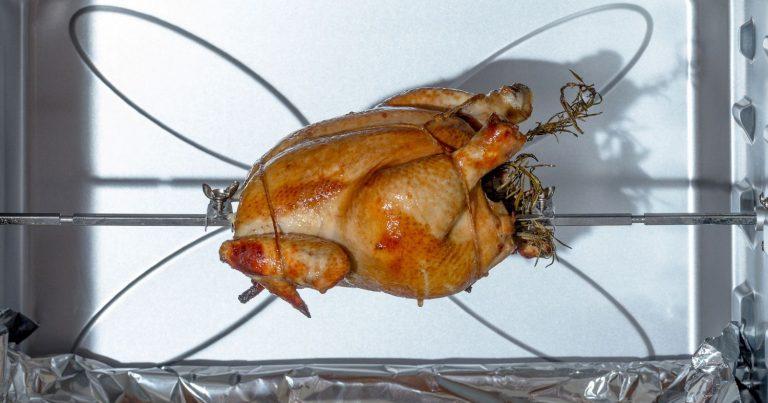 Rotisserie chicken during cooking