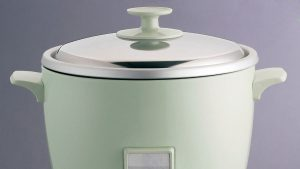 Green rice cooker with a lid on