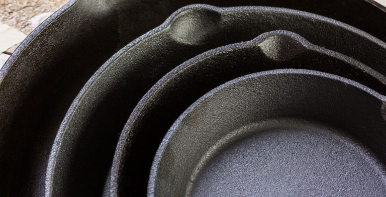 New cast iron skillets and pans placed on top of each other