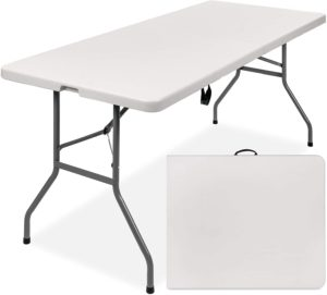 Best Choice 6-Foot Indoor/Outdoor Heavy Duty Folding Table with a white plastic top and steel frame