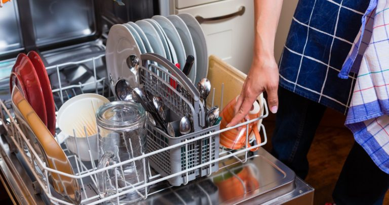 Standard dishwasher being opened and emptied after running a washing cycle
