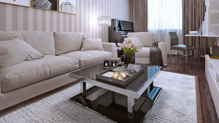 Modern coffee table with a dark glass surface placed in front of a beige sofa in a modern living room
