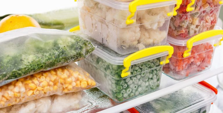 Fully stocked freezer with bags and boxes of vegetables