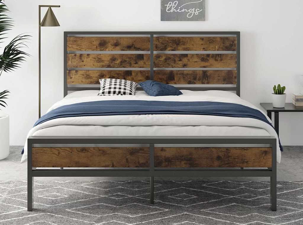 Panel bed with a black metal frame and rustic wood slats in between, standing on a carpeted floor with a lamp and a nightstand