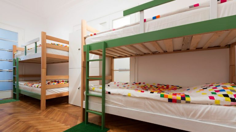 Green and white bunk beds in a row