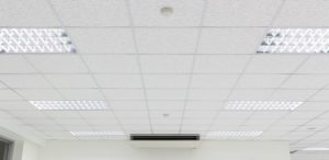Old dropped ceiling with lighting fixtures