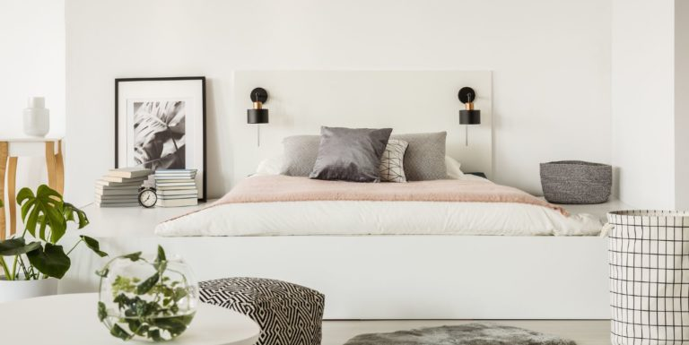 Stylish platform bed with a minimalistic bright appearance