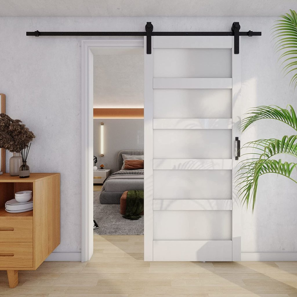 Stylish glass sliding barn door with a white frame and a black hardware kit