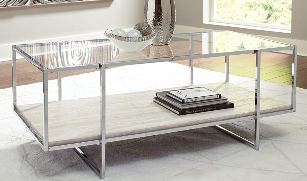 Contemporary cocktail table with a glass top and faux marble design