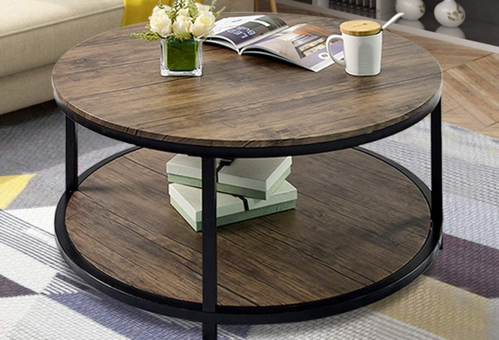 Round coffee table with a wooden top and a black metal frame