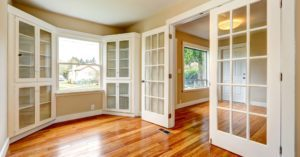 Classic French doors separating living areas inside a house