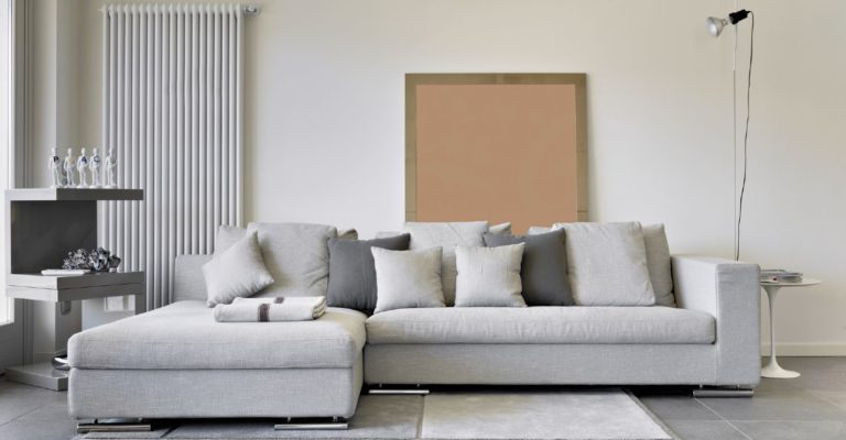 Modern gray sofa with a chaise and lots of pillows