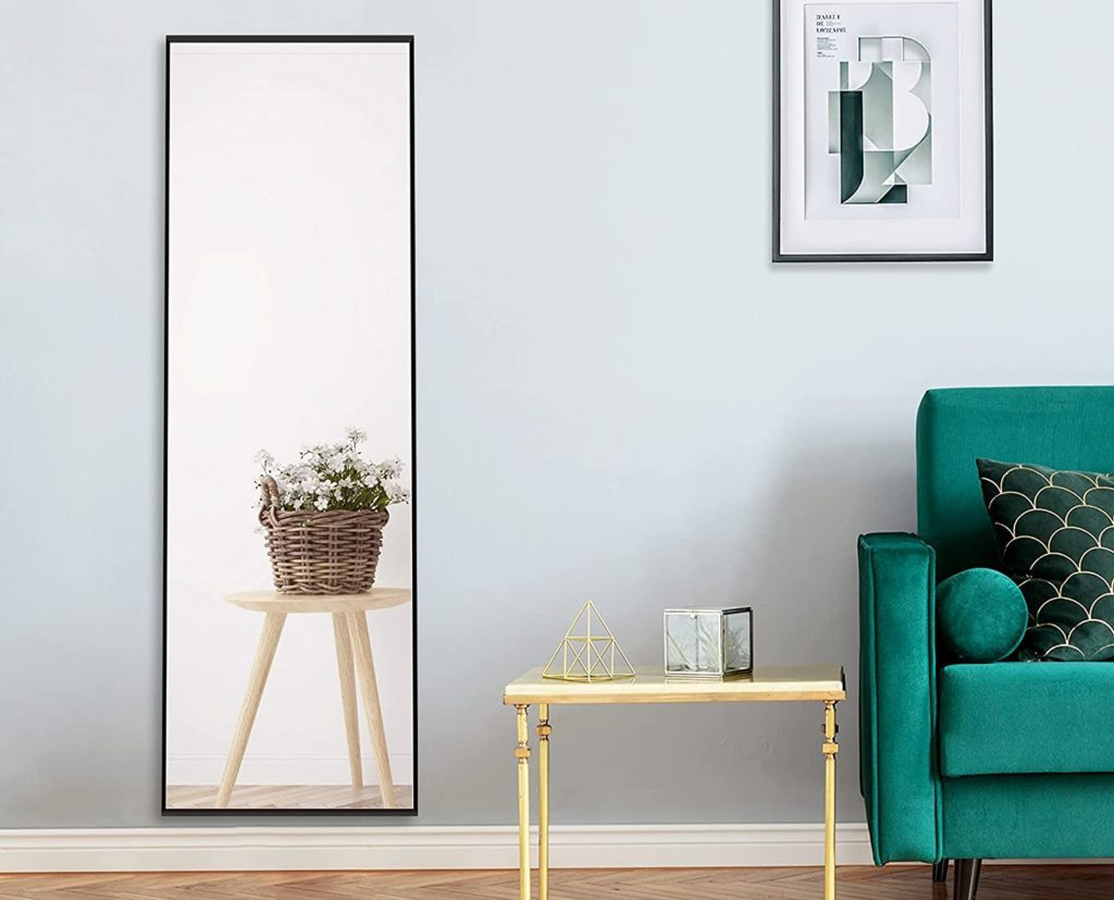 Wall mounted mirror on a gray wall